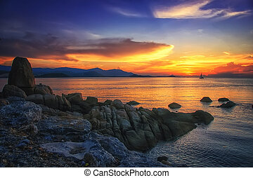 Sunset over the sea at amazing Koh Samui in Thailand with a...