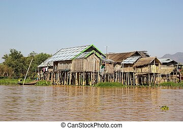 Village with traditional wooden stilt houses on the Lake Inle Myanmar