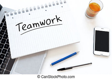 Teamwork - handwritten text in a notebook on a desk - 3d...