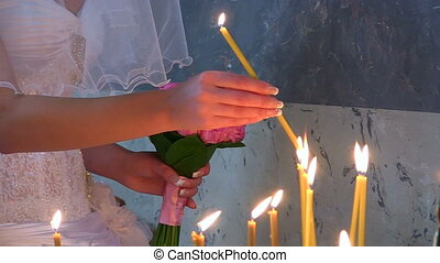 woman hand lighting candles  in a church