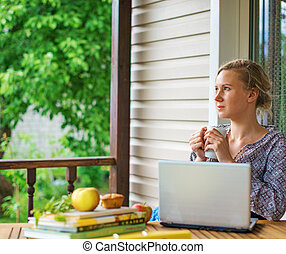 Female writer working on her new book.