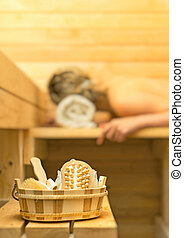 Spa accessories in sauna Woman on background