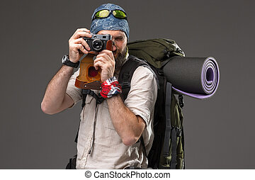 tourist with camera - The tourist with camera. Portrait of a...