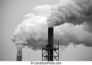 Smoke stacks - Two factory smoke stacks in black and white