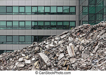 debris - House demolition debris next to modern buildings
