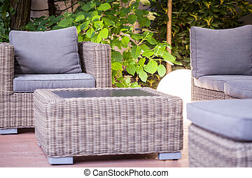 Modern garden furniture - Wicker armchair and table - modern...