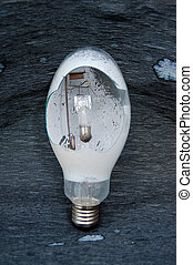 Broken light bulb  - Picture of a damaged broken light bulb