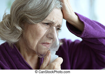 Sick Senior woman with inhaler - Portrait of a sick senior...