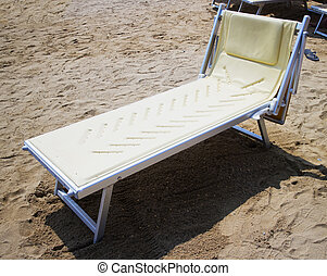 Deckchair - Empty deckchair over sandy beach, horizontal...