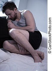 Depressed man trying to sleep - Young man with depression...