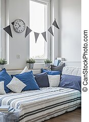 Cushions on the bed - White and blue cushions on the bed