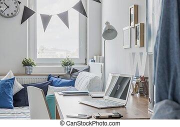 Desk in teen room - Notebook on the desk in teen