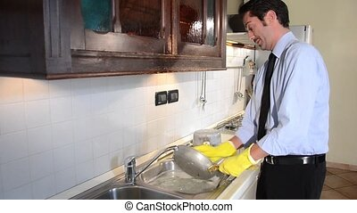 businessman washing dishes at home