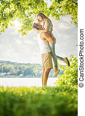 Couple in love on the lake, hug