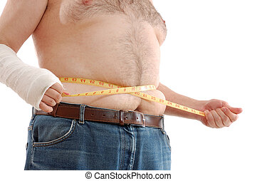 belly fatness - fat man measuring his belly against the...