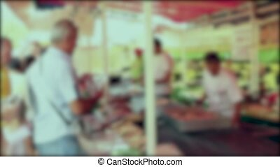 Selling hamburgers. - Blurred people are buying barbecue and...