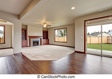 Lovely unfurnished living room with carpet. - Lovely...