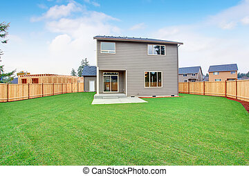 Large back yard with a lot of grass. - Large back yard with...