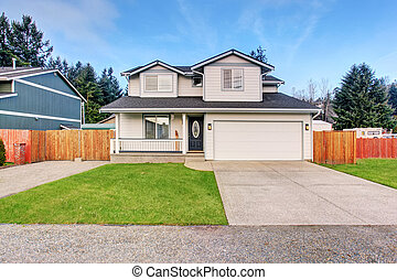 Traditional northwest home with driveway.