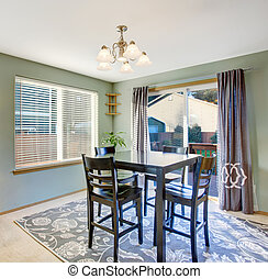 Nice dinning room with carpet and windows. - Well put...