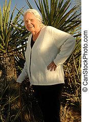 Senior Desert Portrait - Handsome 80 year old woman posing...