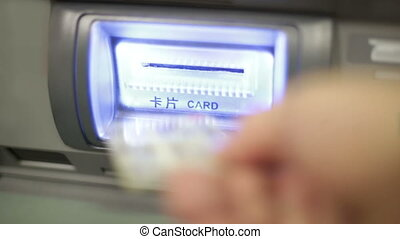 Inserting bankcard at ATM