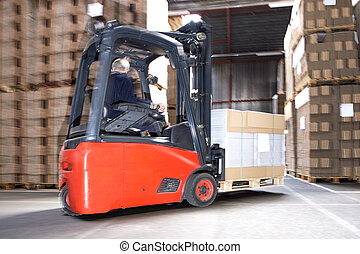 Worker Carrying Stock On Forklift