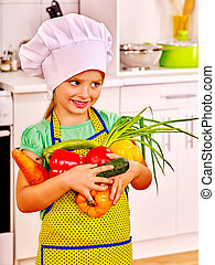 Child cooking at kitchen - Child in cooking hat holding...