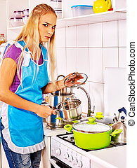 Unhappy tired woman at kitchen. - Unhappy tired woman...