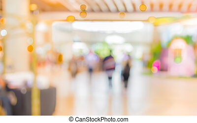 blur image of people in the lobby of a modern business...