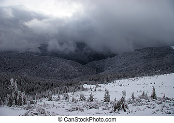Winter mountains with approaching snowstorm - Snow storm is...