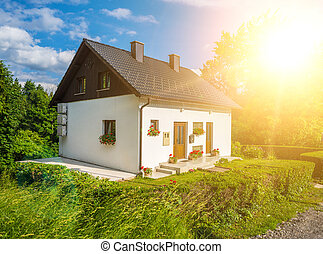 small house with summer sun landscape.