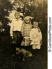 Vintage Siblings - Three siblings in a garden portrait with...