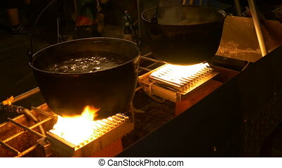 Night Cauldron Food Cooking - Two large cauldrons placed on...