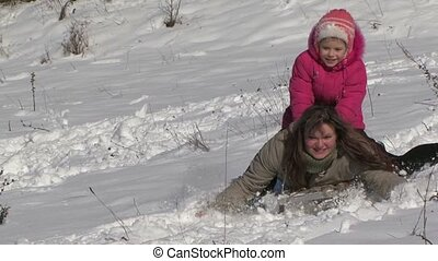 Girl Riding A Mother With A Snow Slide. - Winter, snow,...