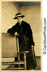Vintage Miss - Vintage portrait of a young woman in a fur...
