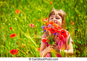 Cute child girl with bouquet of wildflowers