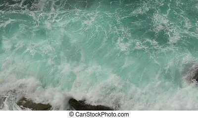 Waves Atlantic Ocean Breaking onto Rocks, closeup