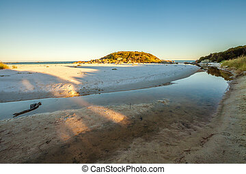 Tasmania East Coast - White Taylors Beach is reflected in...