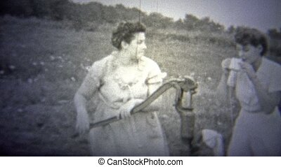 OKLAHOMA, USA - 1943: Women pumping - Original vintage 8mm...