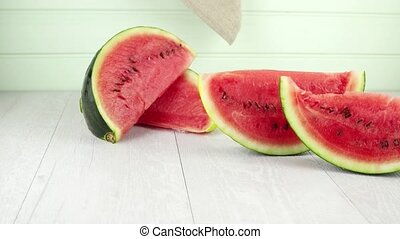 Watermelon slices on wooden vintage background.