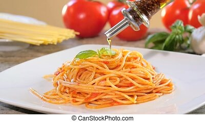 pouring olive oil over spaghetti - Traditional italian...