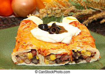 Three Bean Enchilada - Plate with three bean enchilada with...