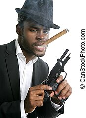 African american mafia man smoking cigar with handgun...
