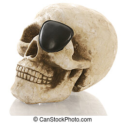pirate skeleton - human skull with eye patch on white background