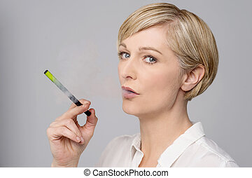 Woman with e-cigarette. - Image of a modern woman smoking...