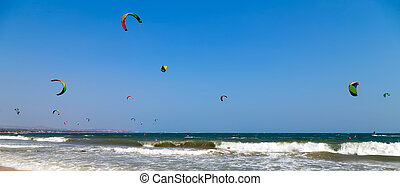 Kite Surfer Ridings in sea wave