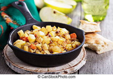 Root vegetable hash with apple, potato and carrots