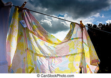Washday Blues - Laundry hanging on washing line in sun with...