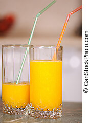 Juice in a glass - Orange juice in a glass on a table